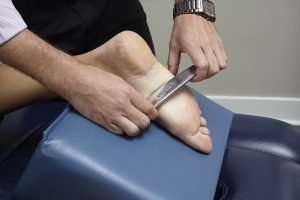 Dr. Hankins using Graston Technique to relieve foot pain